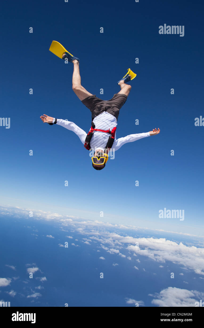 Skydiver in snorkel gear over north shore of Oahu, Hawaii - Stock Image