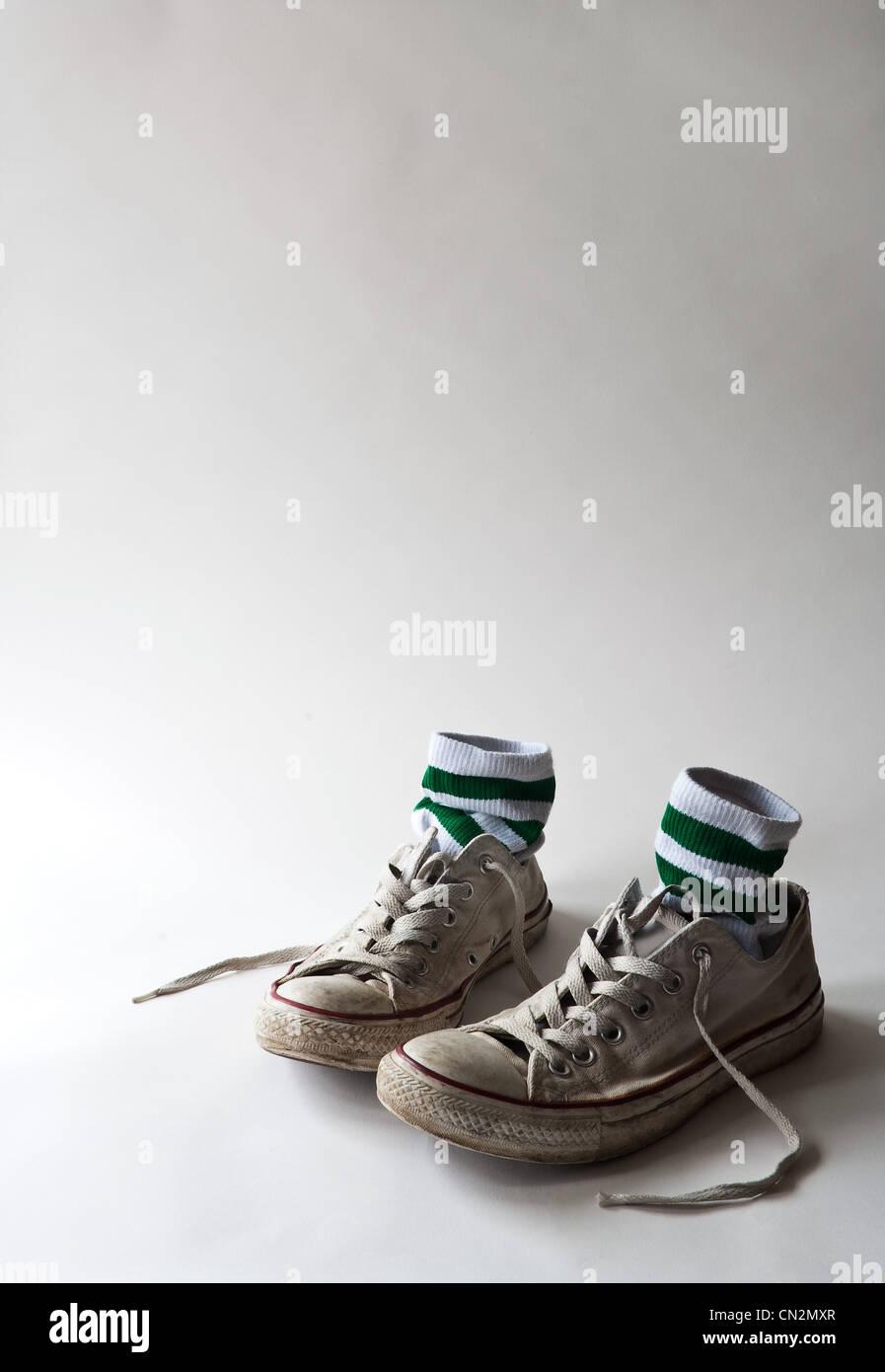 Pair of training shoes and socks, studio shot - Stock Image