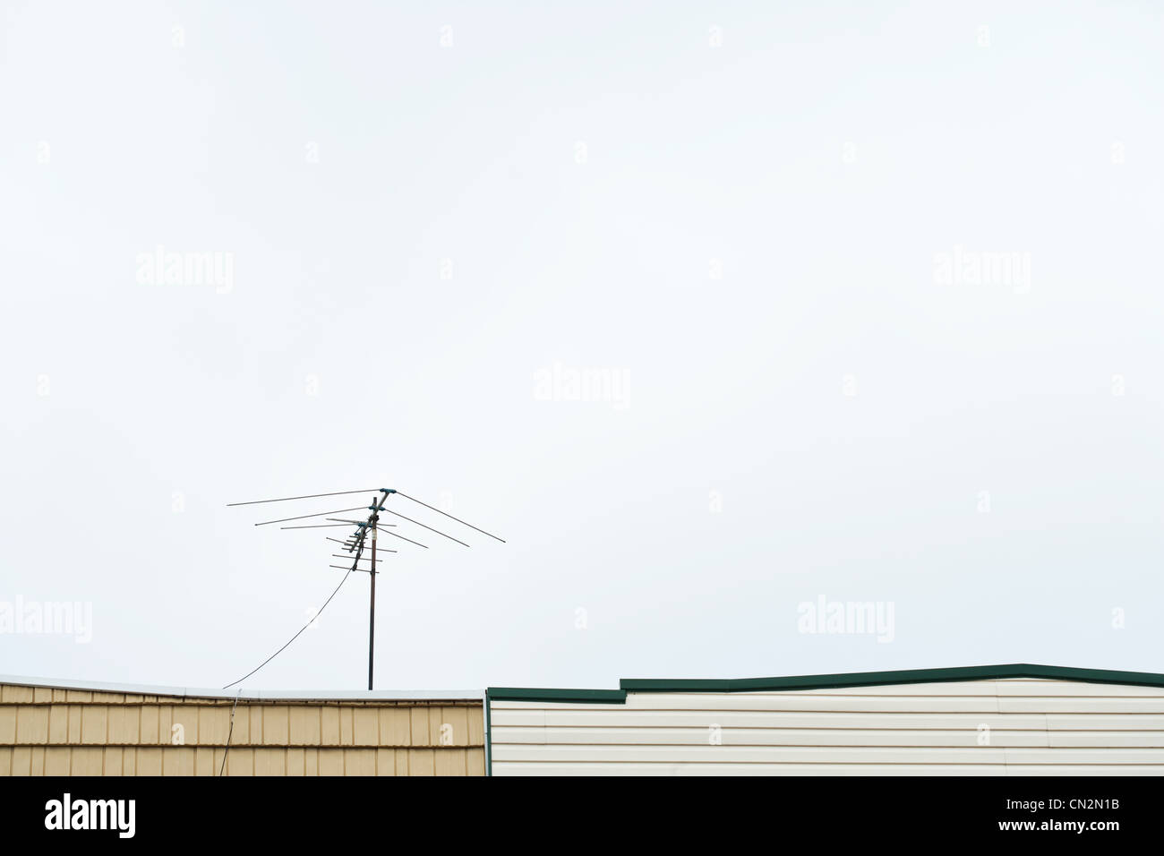 Television aerial on roof - Stock Image