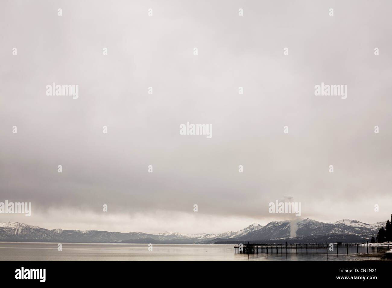 Mountains and jetty, Lake Tahoe, California, USA - Stock Image