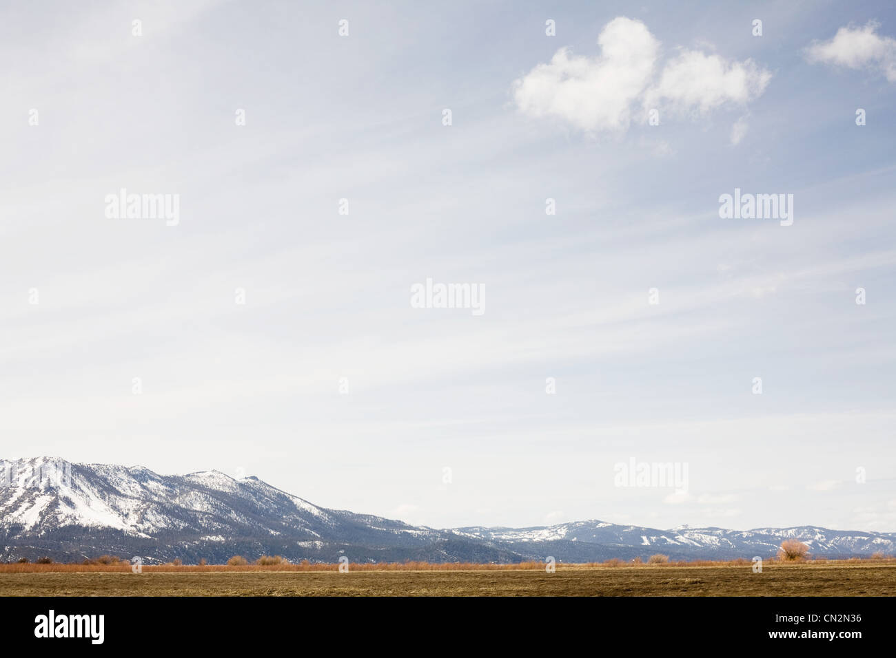Snowcapped mountains and prairie, California, USA - Stock Image