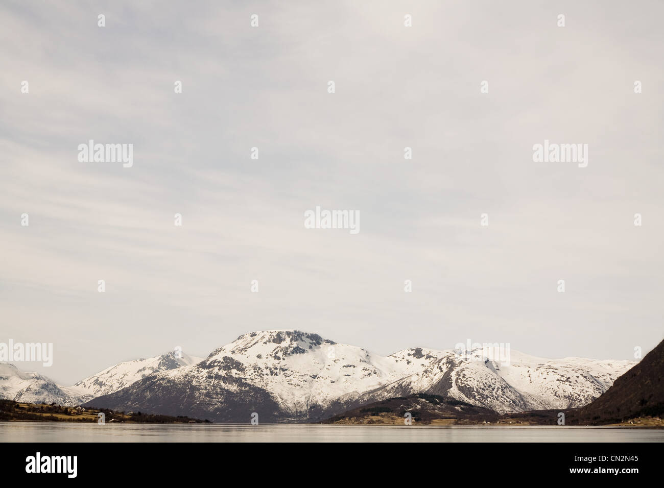 Snowcapped mountains and fjord, Lofoten, Norway - Stock Image