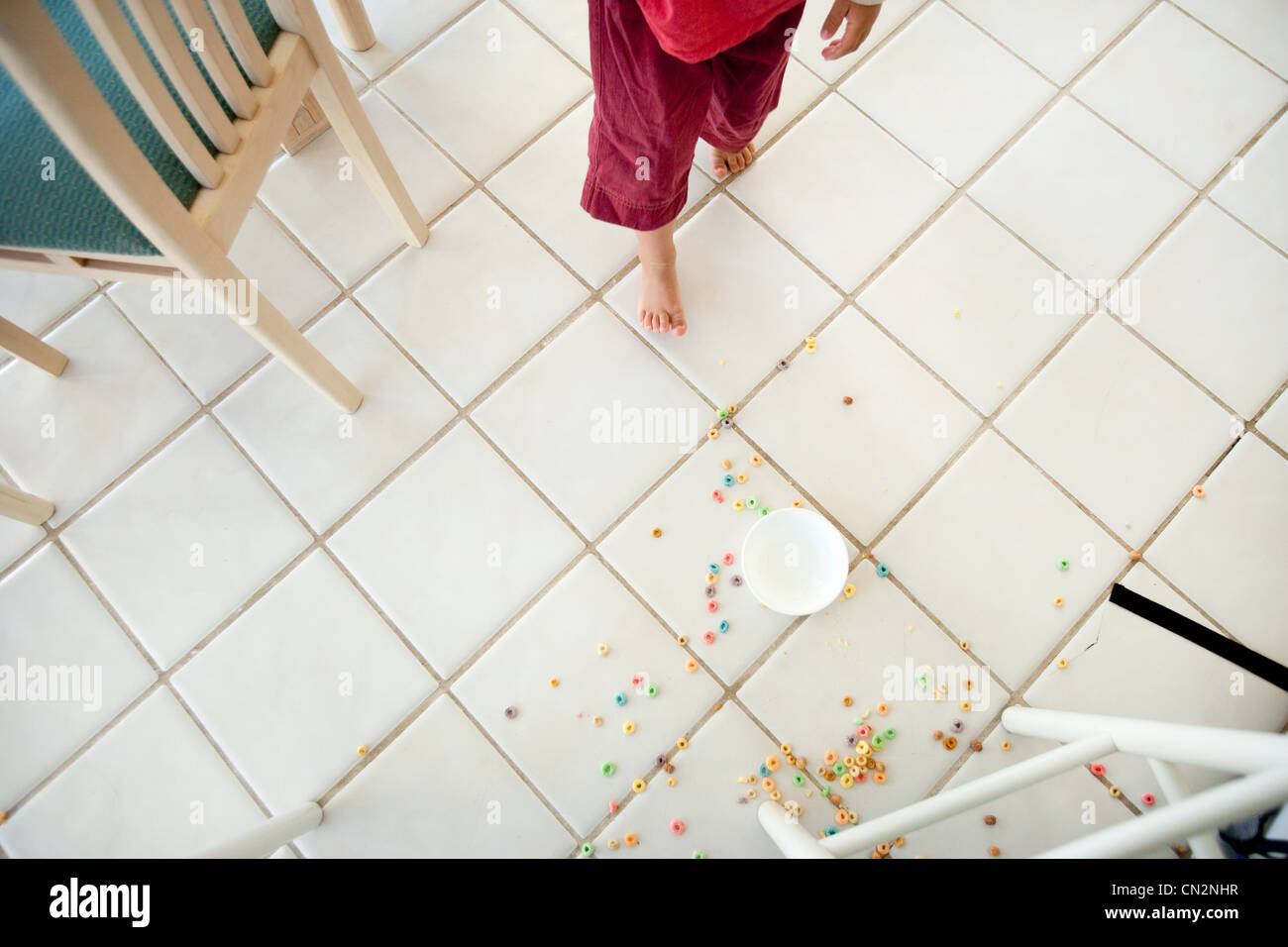 Breakfast cereal spilt on kitchen floor - Stock Image