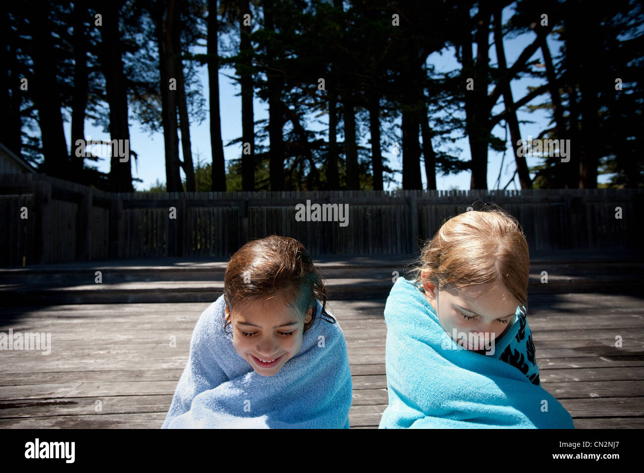 Two children wrapped in towels - Stock Image
