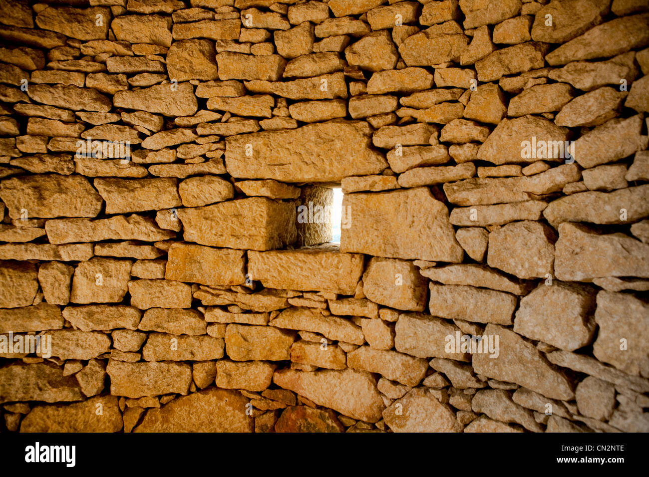 Square window in stone wall - Stock Image
