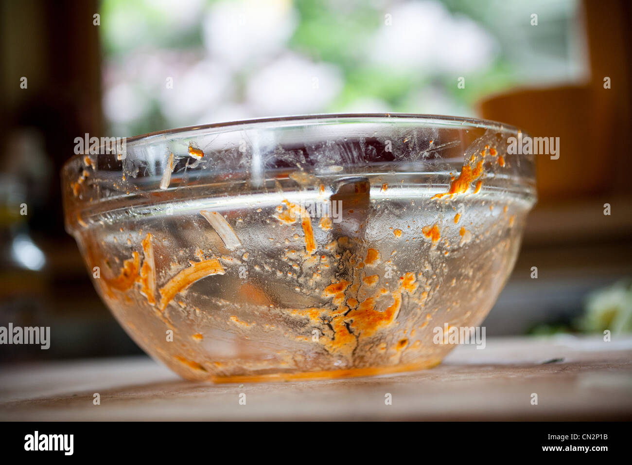Dirty mixing bowl used for cooking - Stock Image