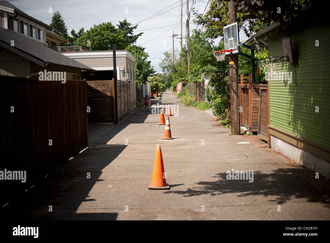 Traffic cones in alley - Stock Image