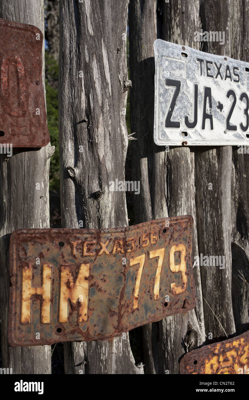 Old License Plates Nailed to Wood Fence, Texas, USA - Stock Image
