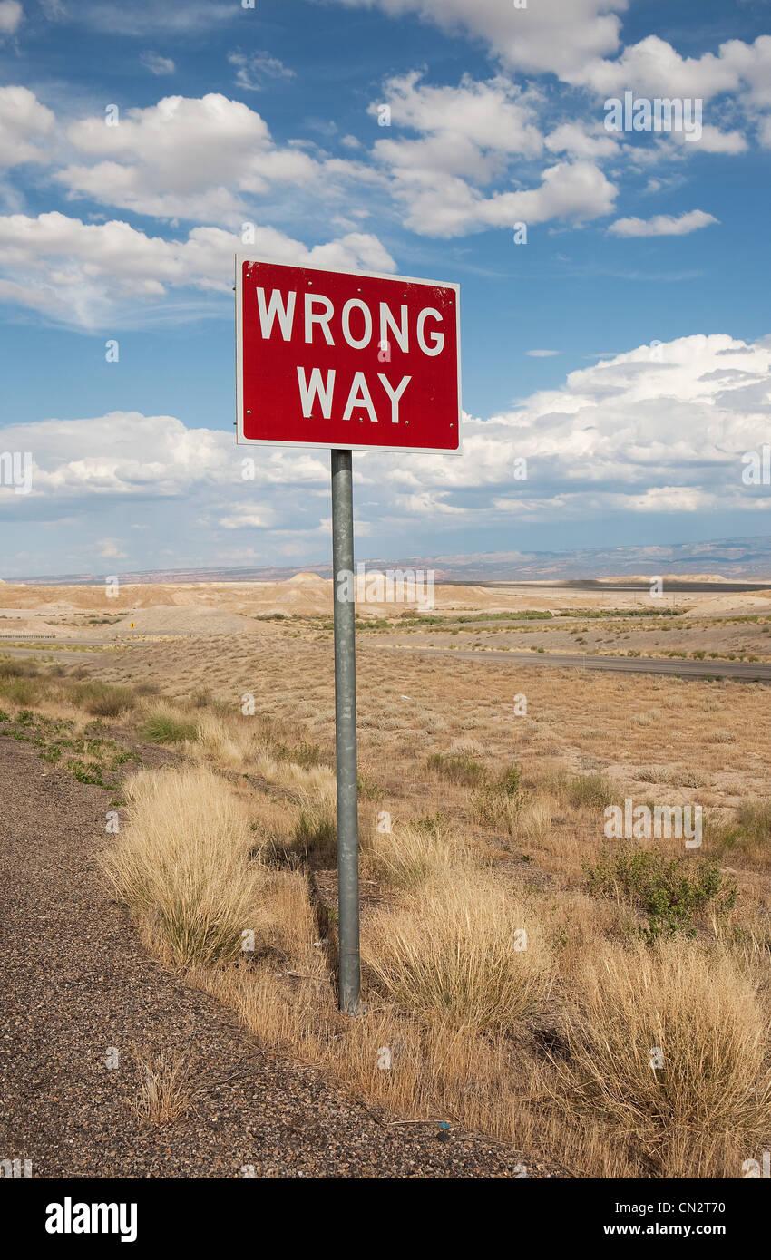 Wrong way sign at side of highway, Utah, USA - Stock Image