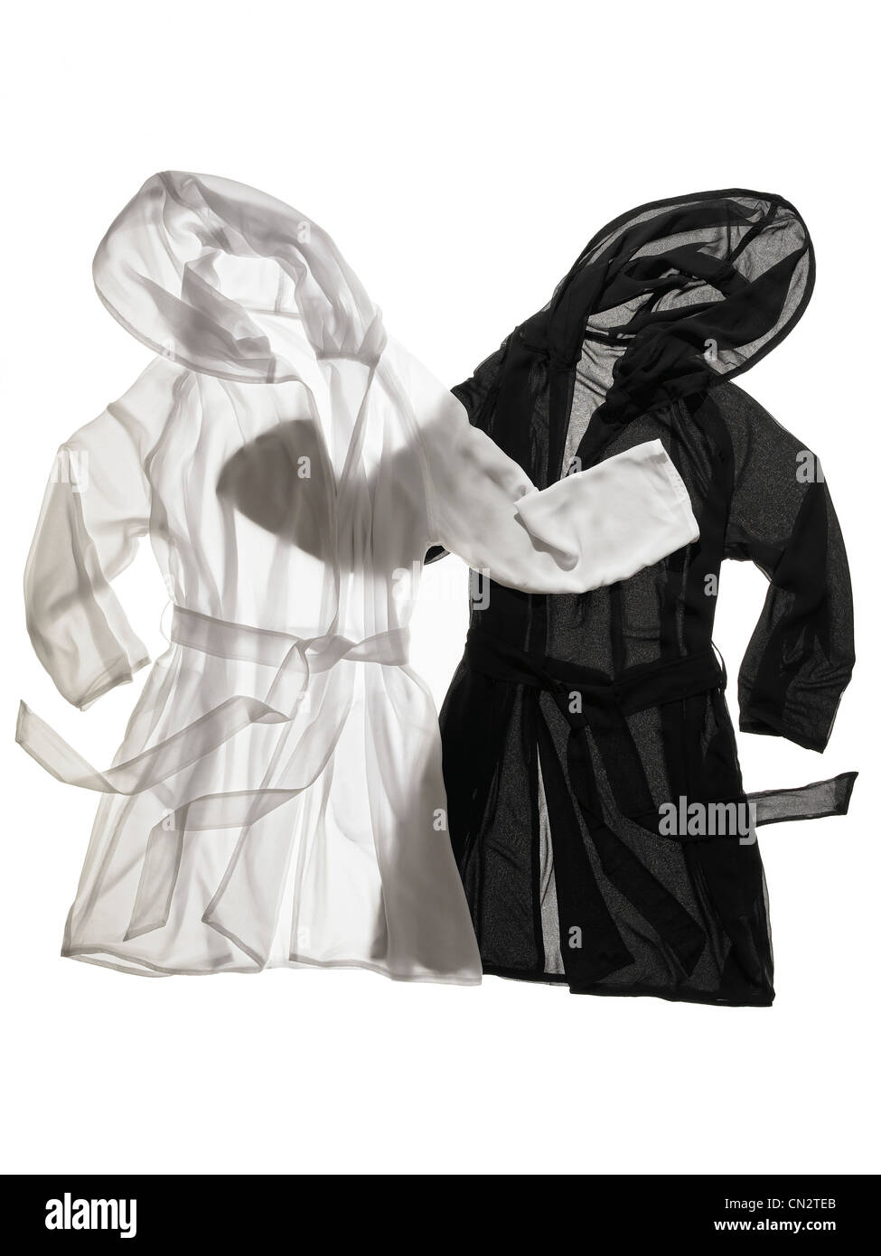 Black and White Sheer Hooded Robes - Stock Image