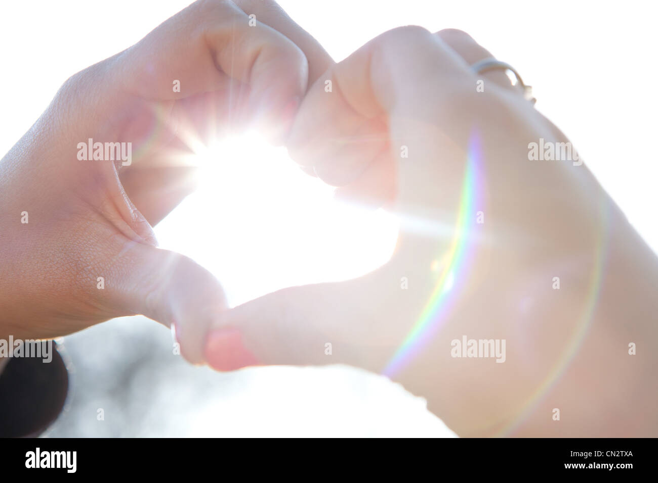 Hands making heart shape - Stock Image