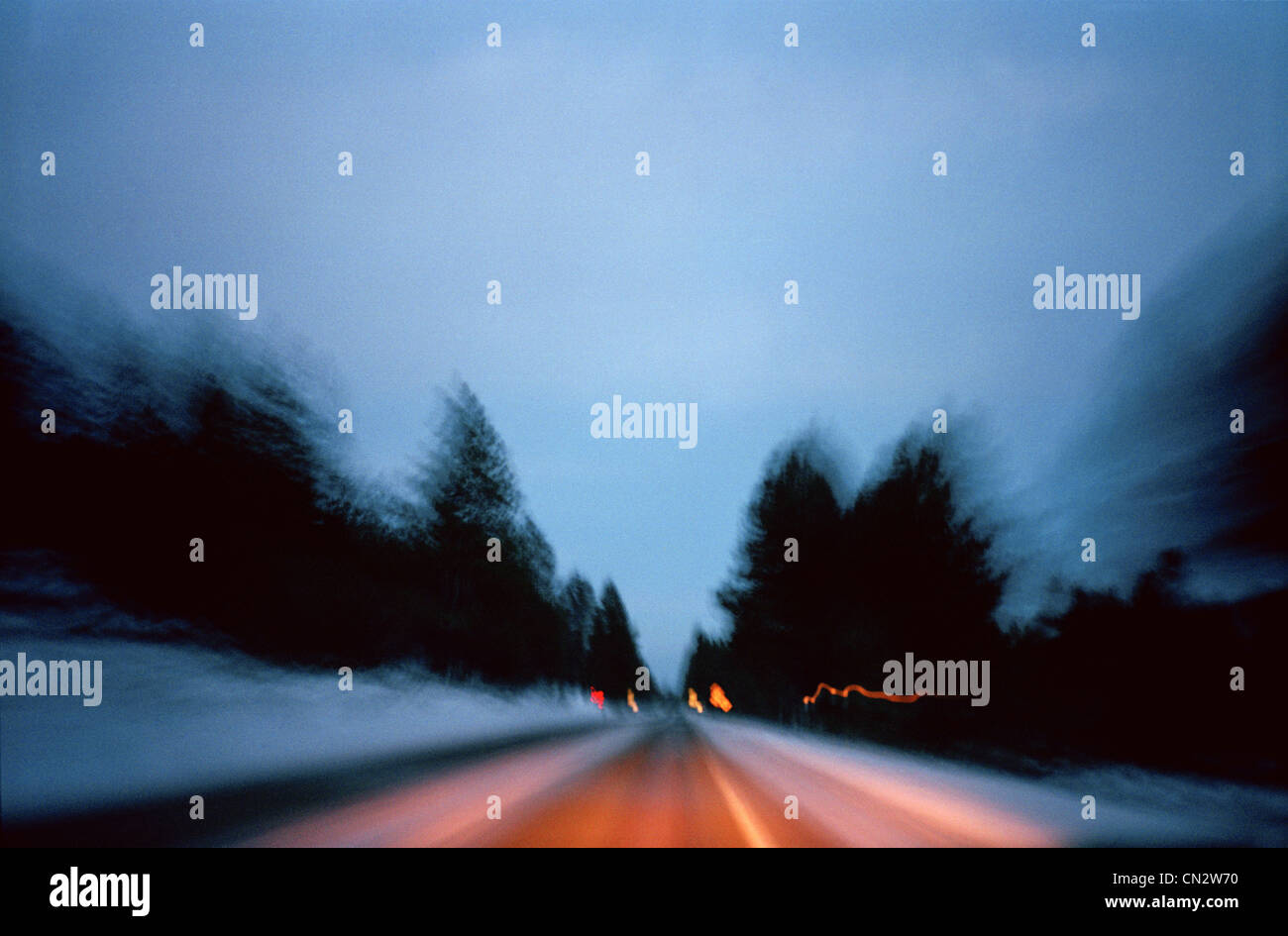 Blurry road in the evening - Stock Image