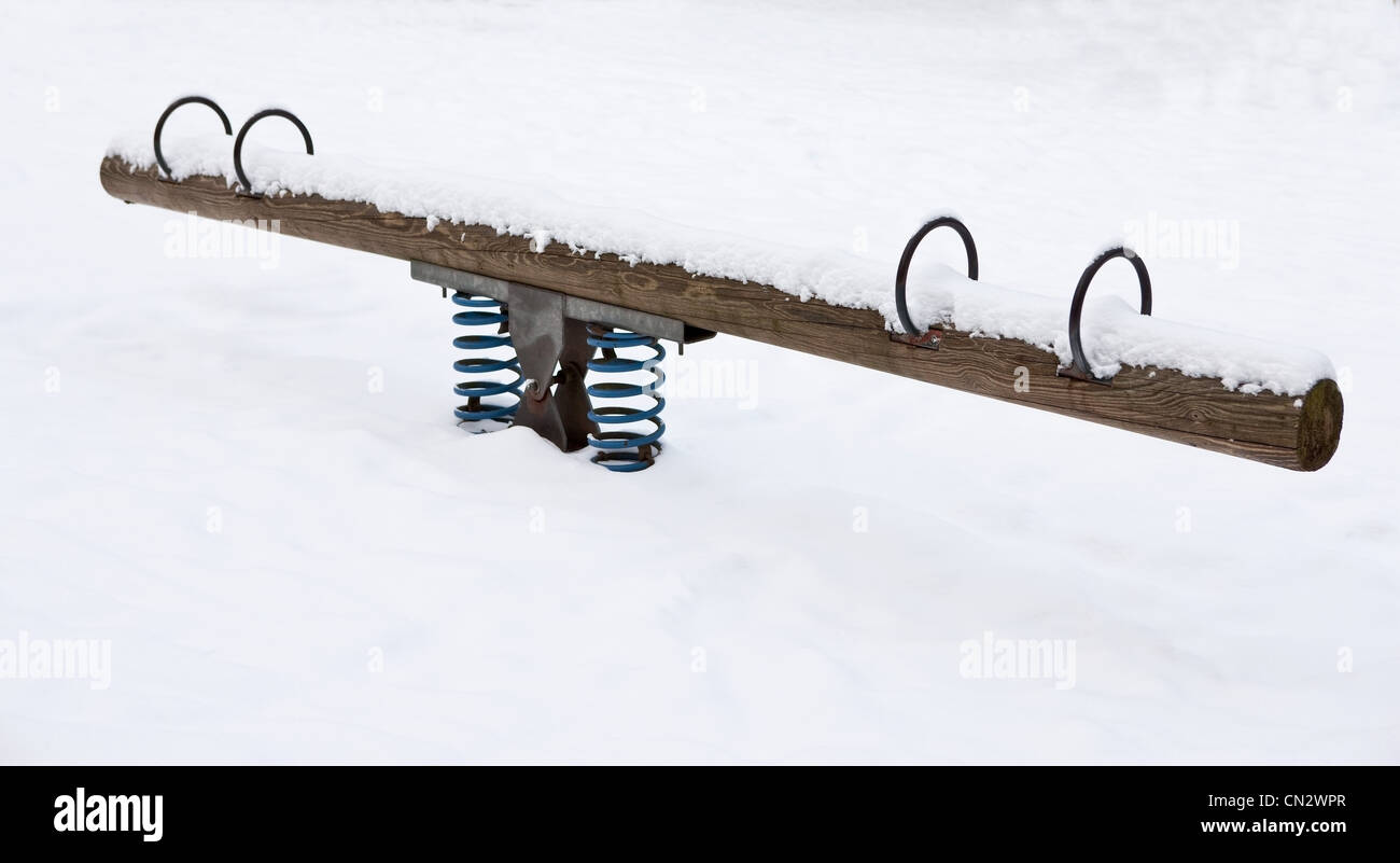 Seesaw covered in snow - Stock Image