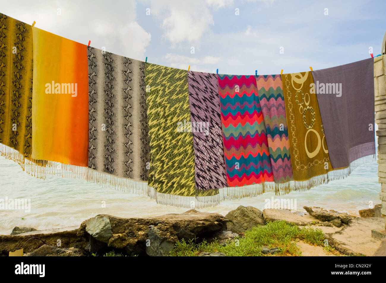 Blankets on clothesline, Pigeon Point, Tobago - Stock Image
