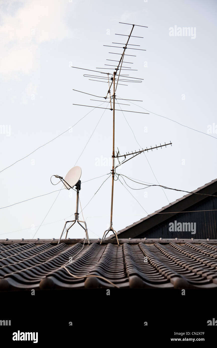 Television aerial on rooftop - Stock Image
