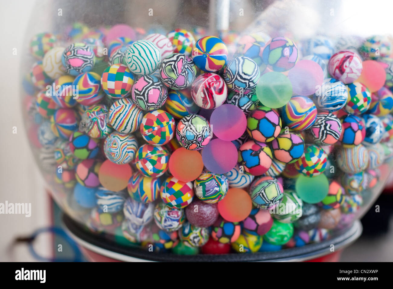 Colorful balls in vending machine - Stock Image