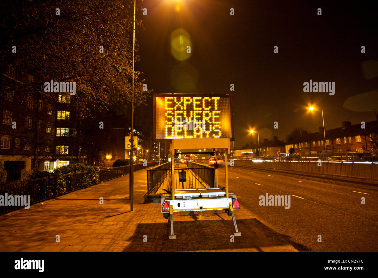 Road sign in urban scene at night, London, England - Stock Image