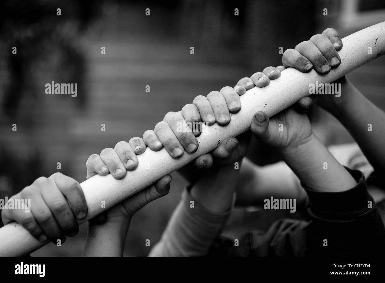 Children  holding on to railing - Stock Image