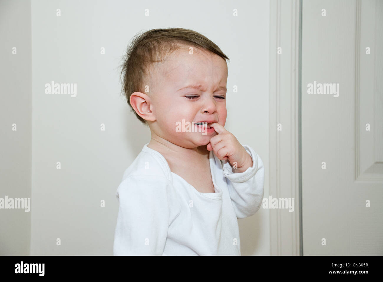 Baby boy crying - Stock Image