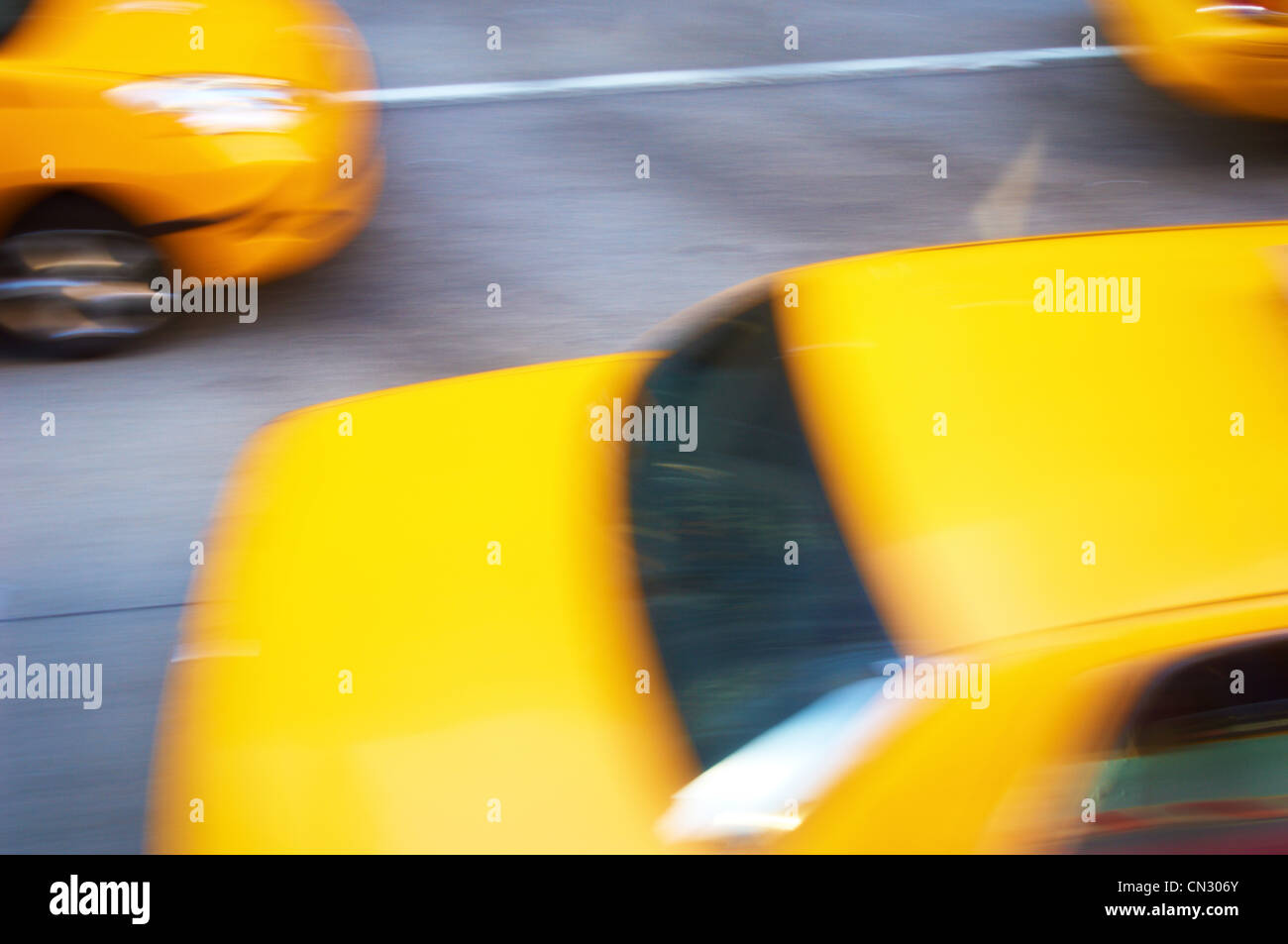Yellow taxis in motion, New York City, USA Stock Photo