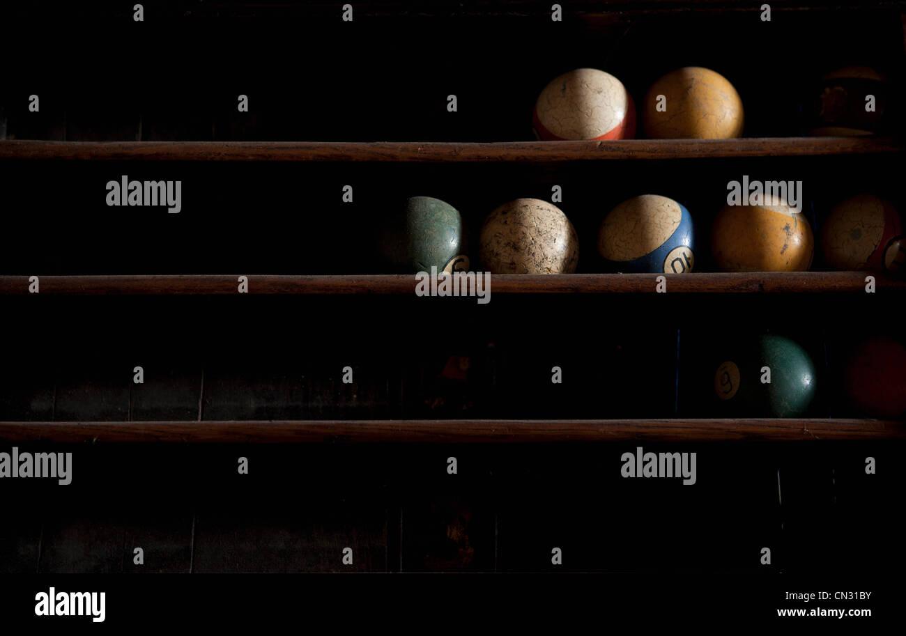 Pool balls on shelf - Stock Image