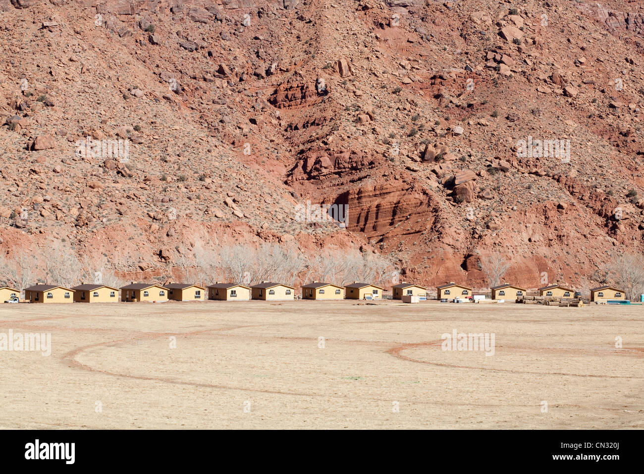 Row of huts by canyon, Moab, Utah, USA - Stock Image