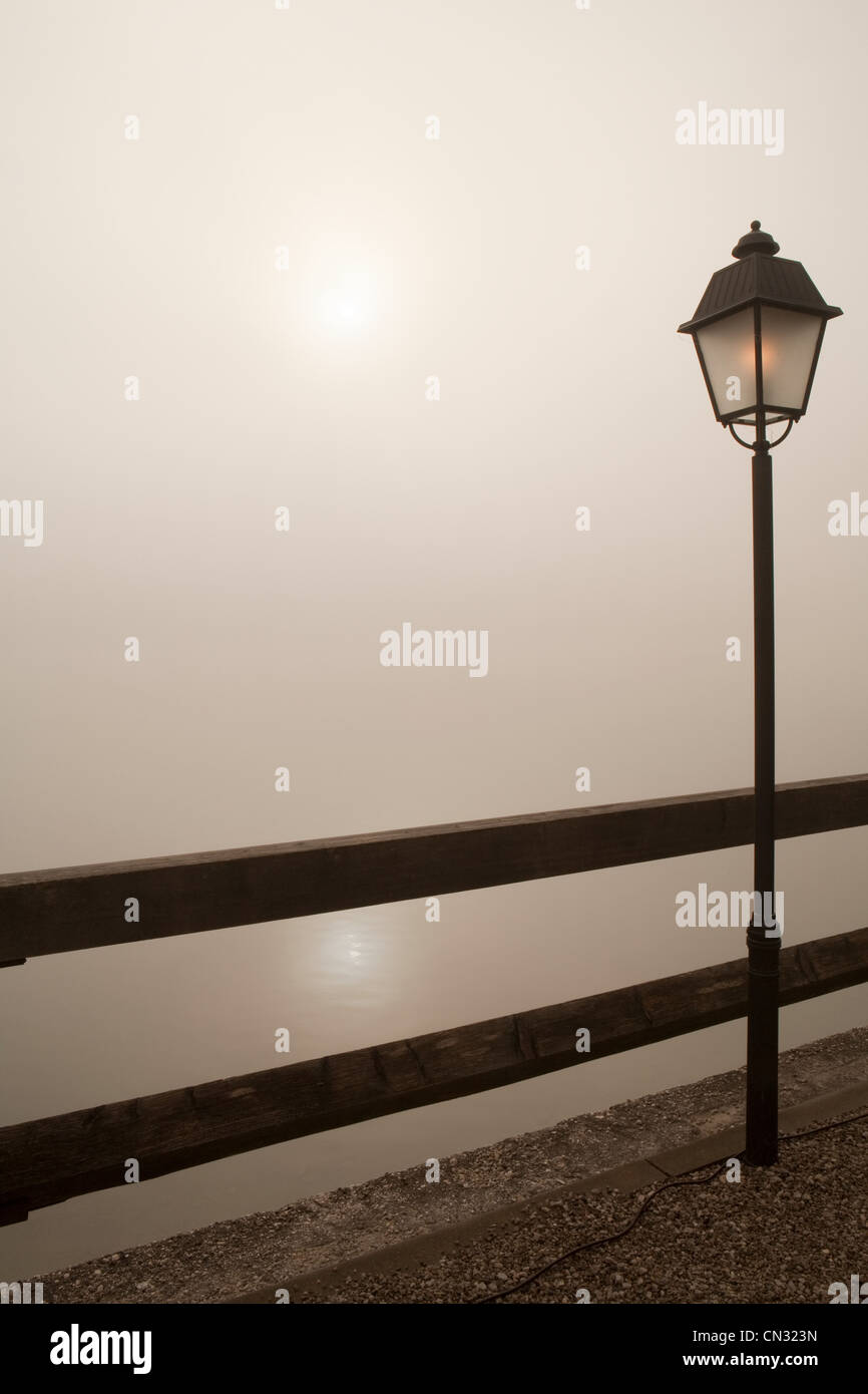 Lamp post by wooden fence - Stock Image
