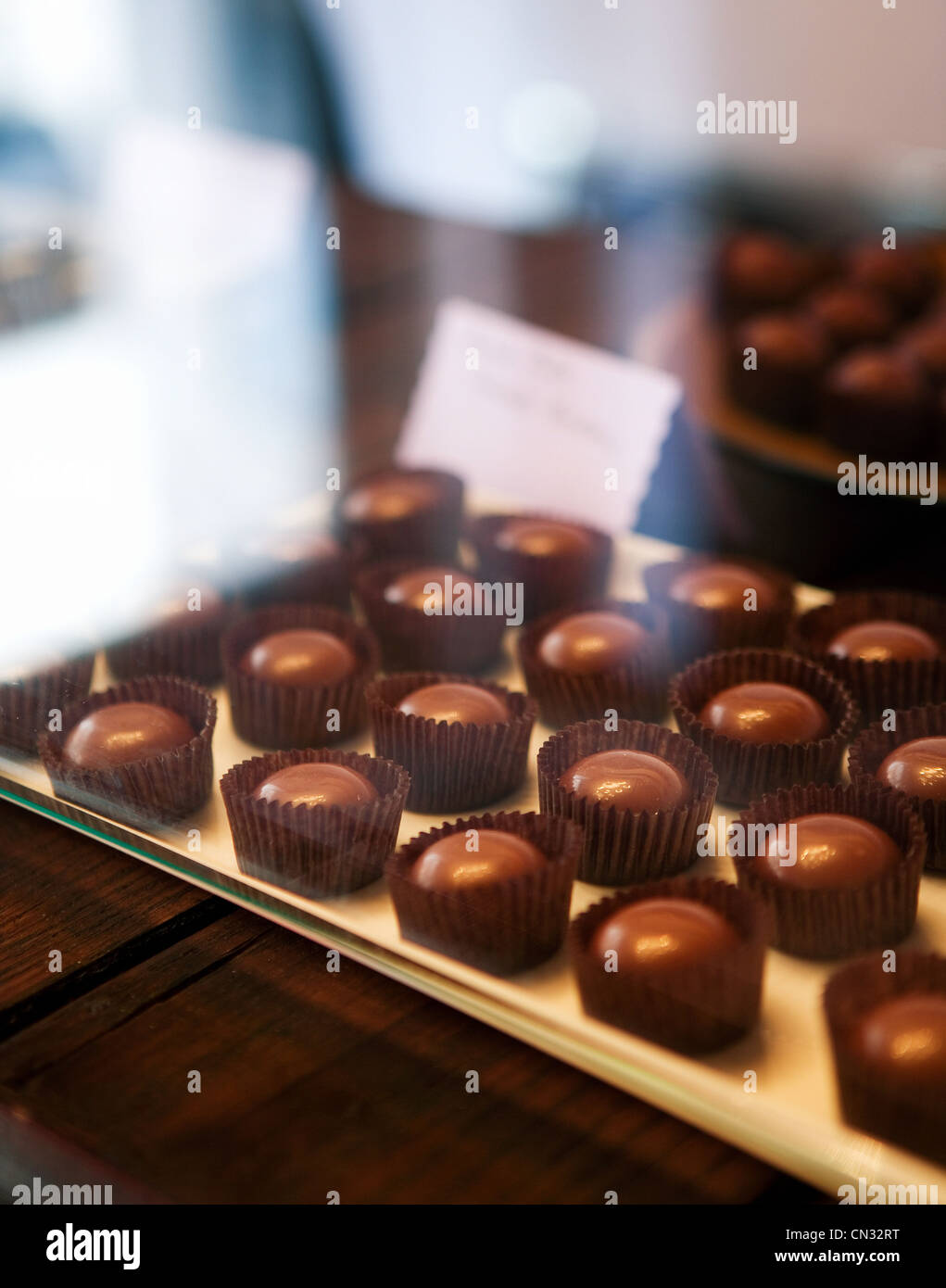 Chocolates in display case - Stock Image