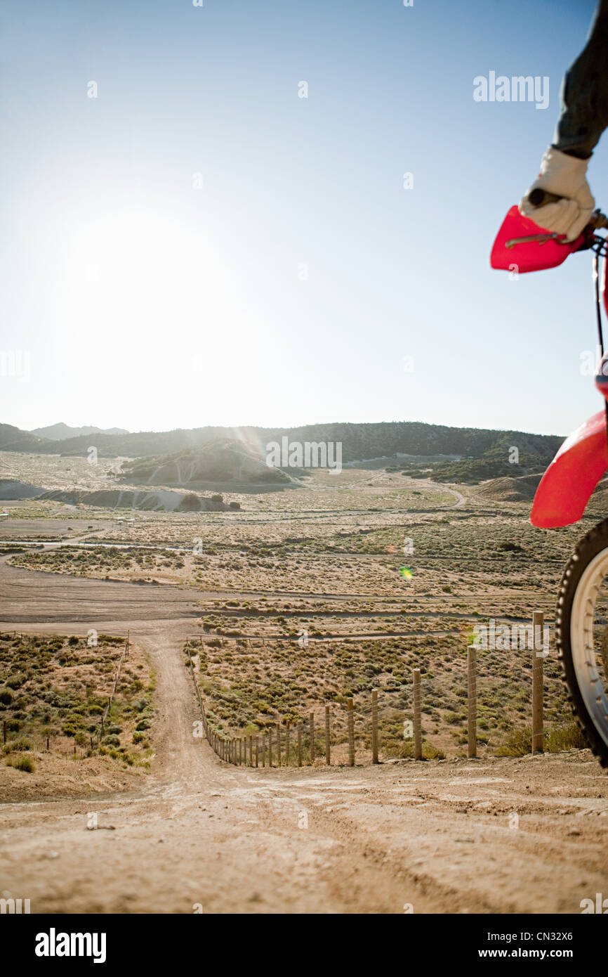 Man with dirt bike on hill - Stock Image