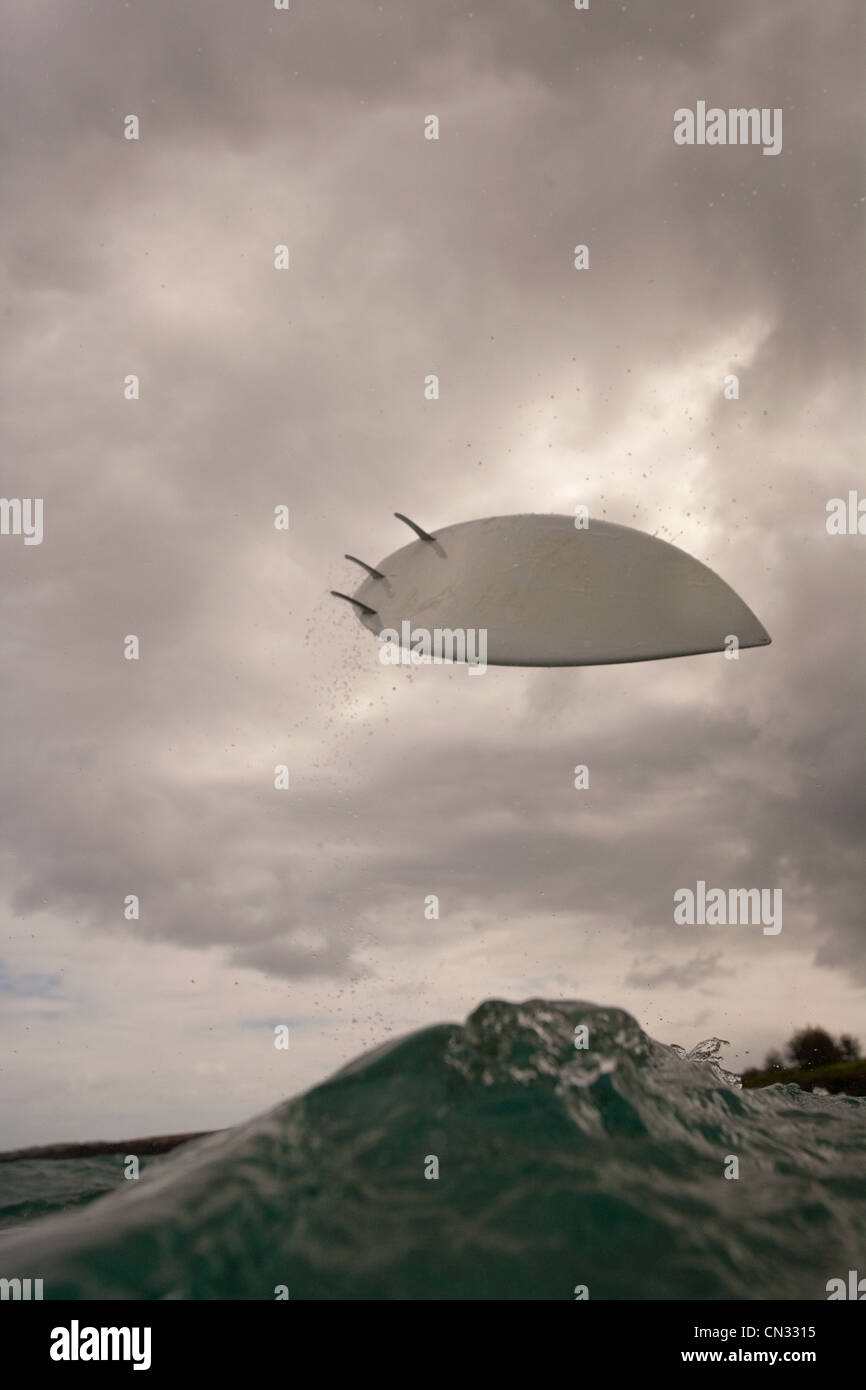 Surfboard in the air - Stock Image