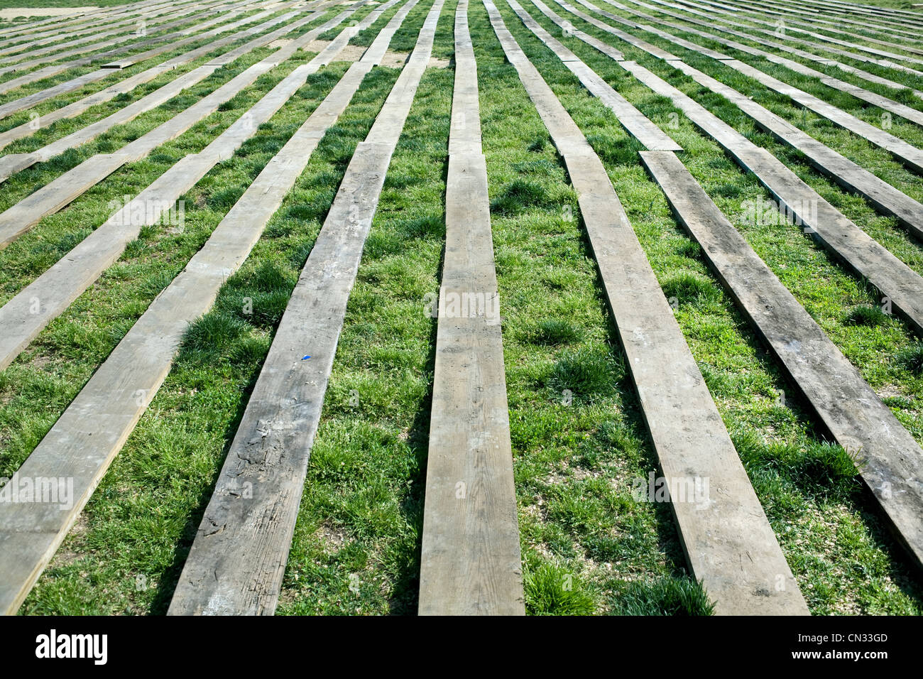 Wooden planks on grass - Stock Image