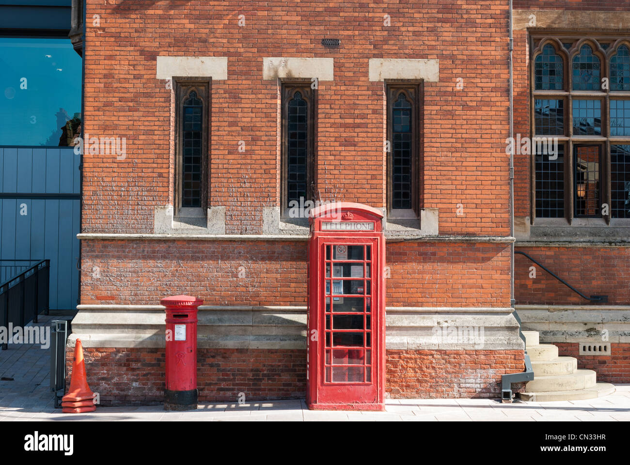 Red telephone kiosk and post box outside the Royal Shakespeare Theatre in Statford upon Avon - Stock Image
