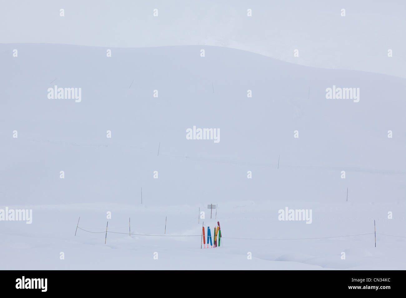 Multicolored poles in the snow,Grand Massif, French Alps - Stock Image