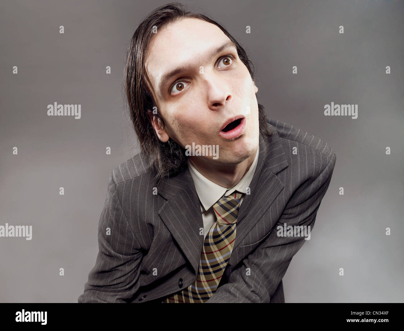 Businessman with blank expression - Stock Image