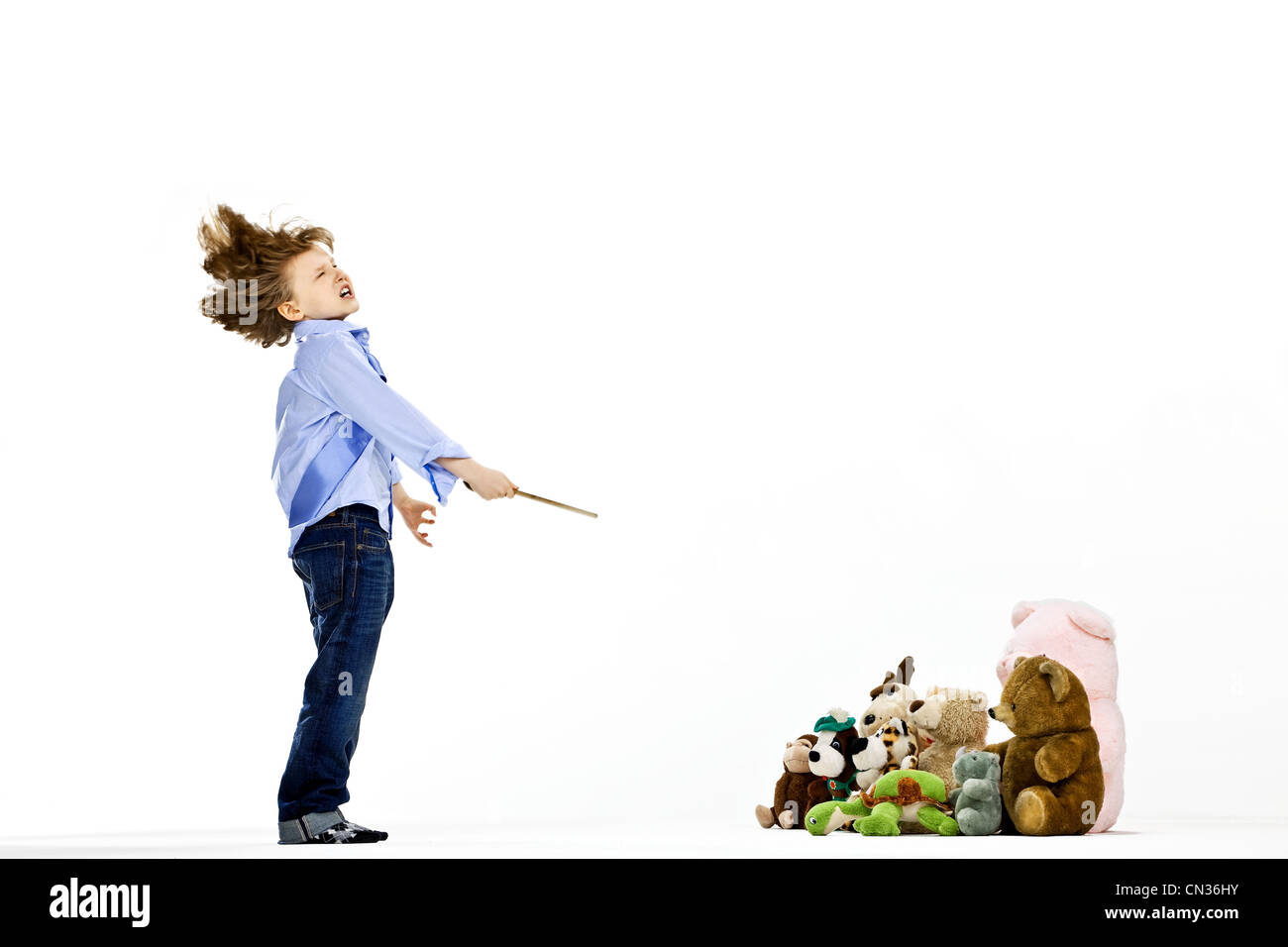 Boy pretending to be musical conductor - Stock Image