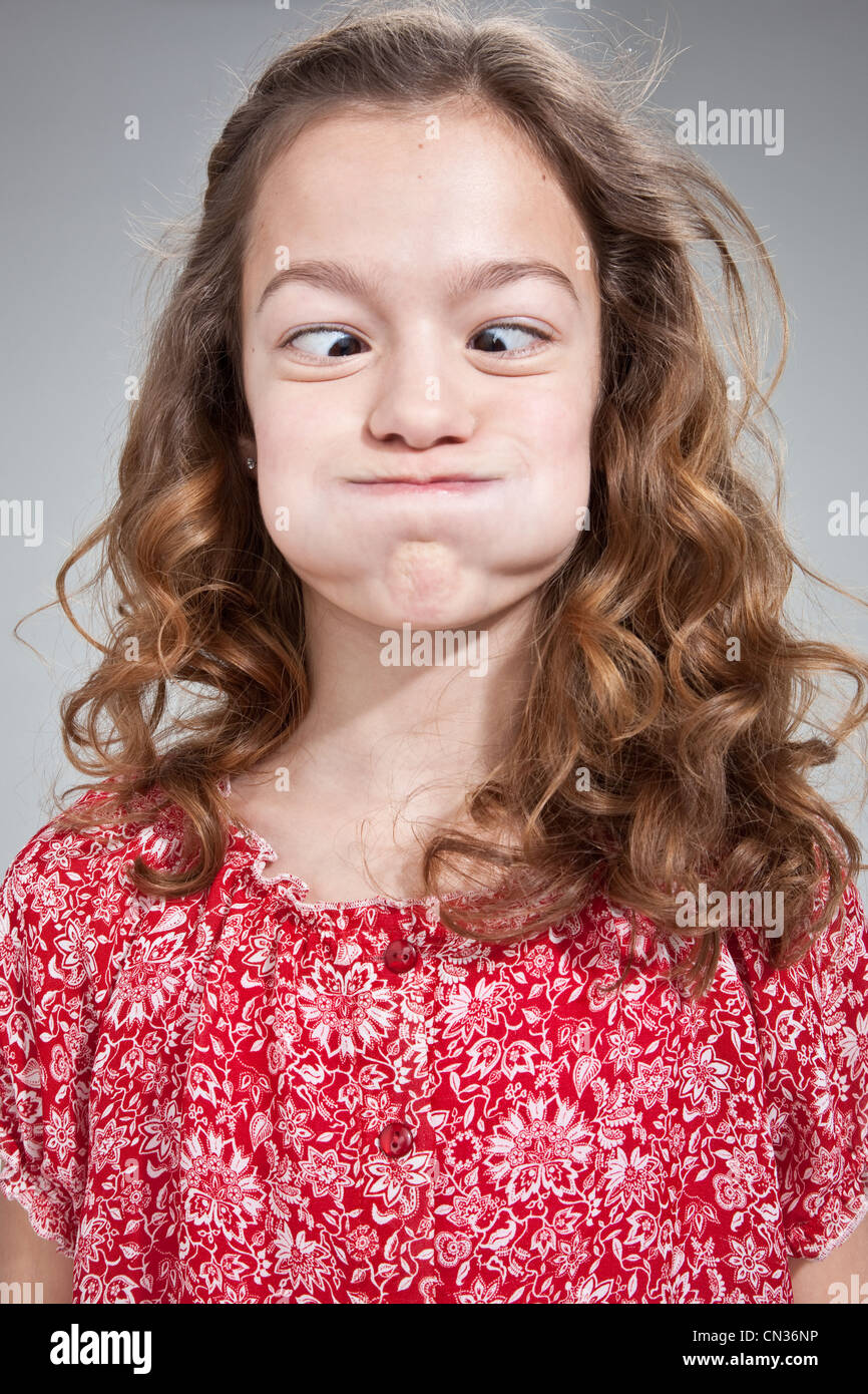 Girl pulling funny face Stock Photo