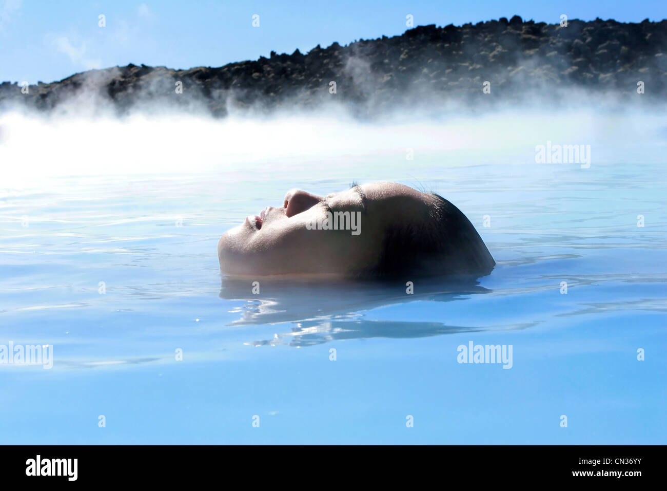 Woman in geothermal pool, Iceland - Stock Image