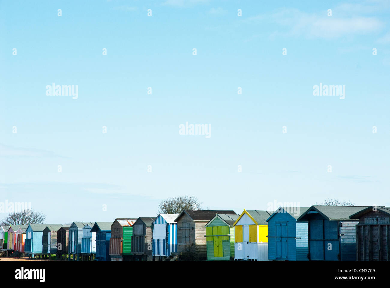 Beach huts in a row, Whitstable, Kent, England, UK Stock Photo