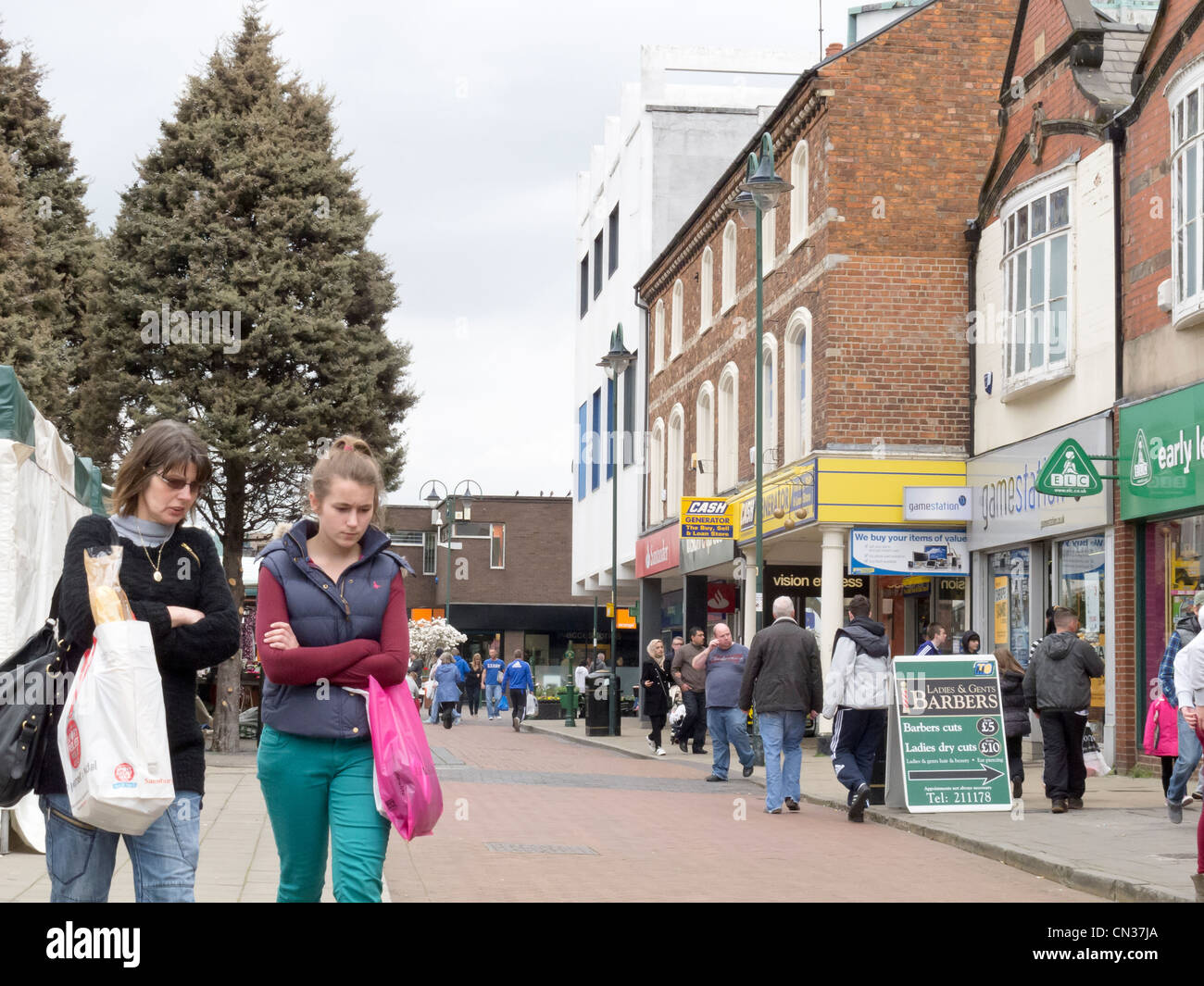 Crewe on a March Saturday pedestrianized shopping zone and female shoppers - Stock Image