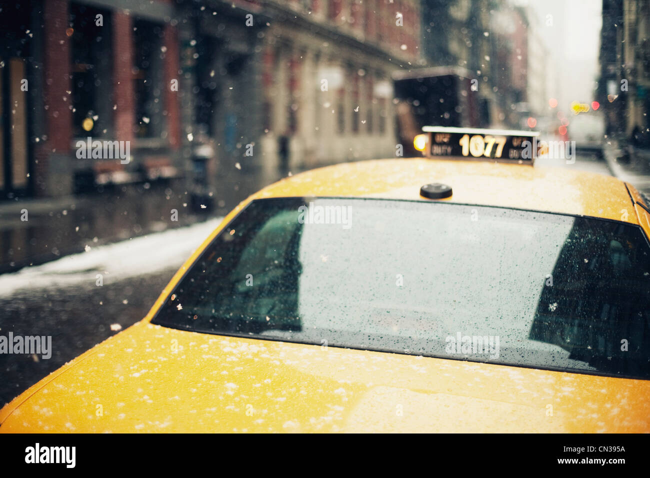 New York taxi in the snow - Stock Image