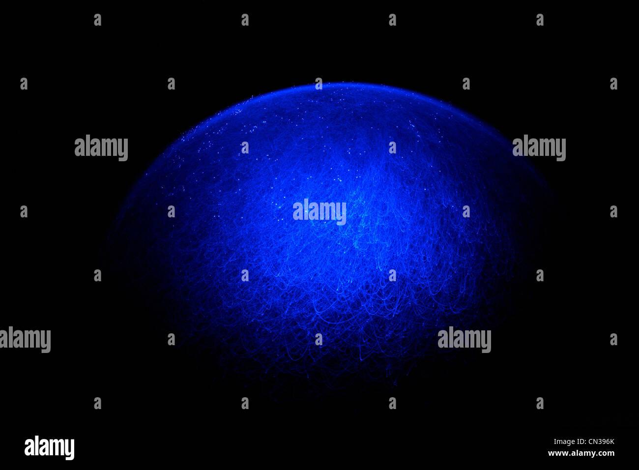 Blue fibre optic light pattern - Stock Image