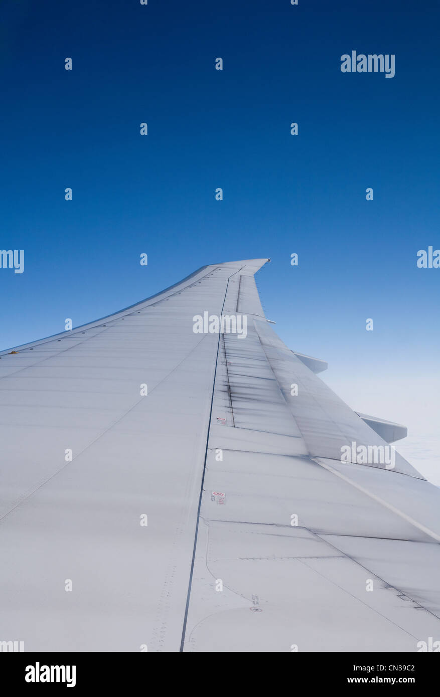 Airplane wing seen from inside commercial jet - Stock Image