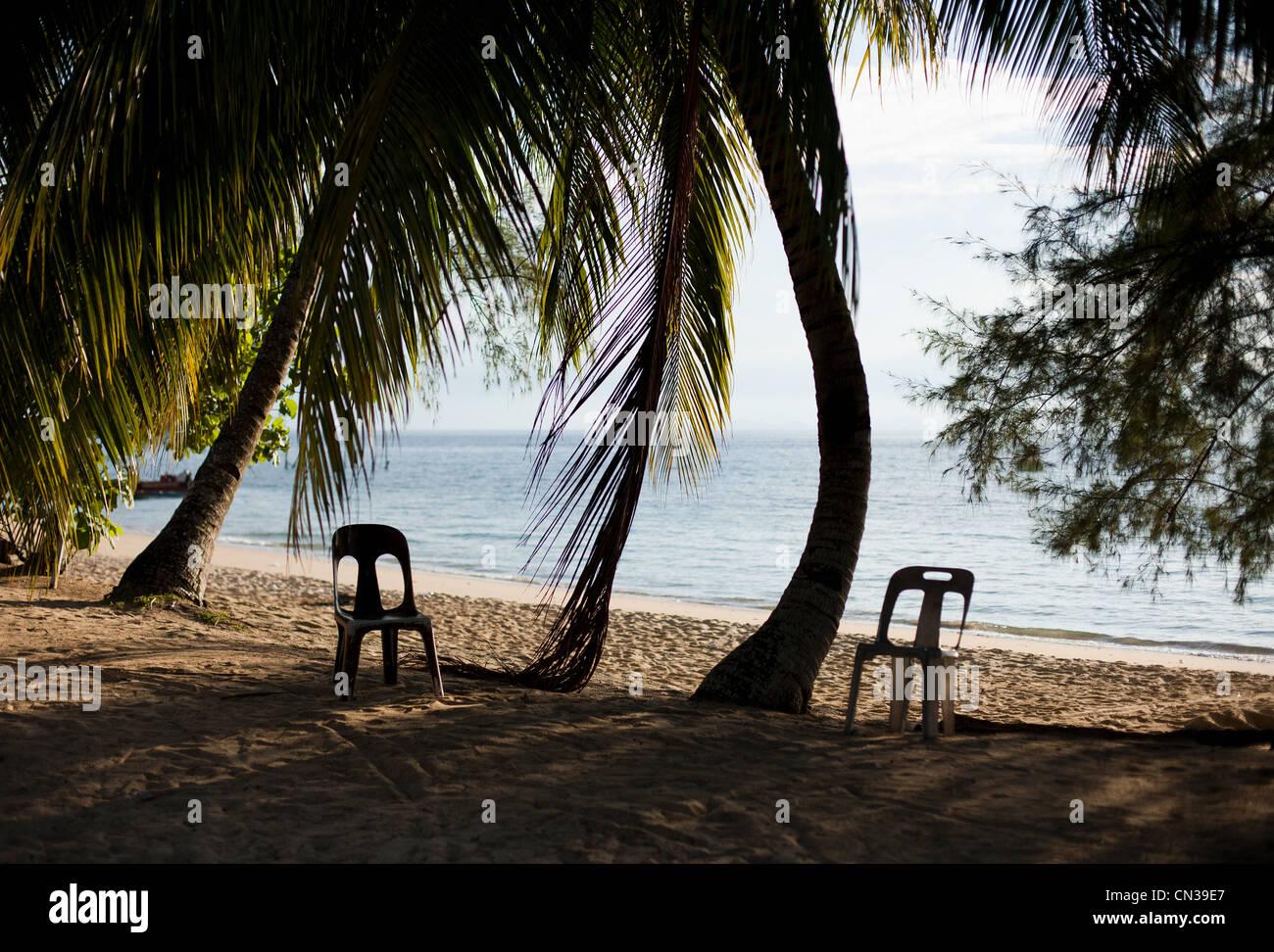 Chairs on a tropical beach, Tioman Island, Malaysia - Stock Image