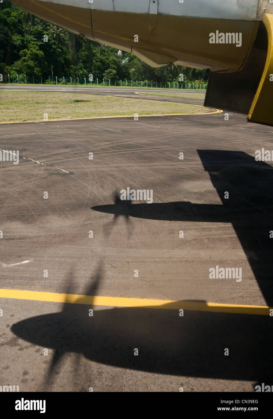 Airplane and shadows of propellers - Stock Image