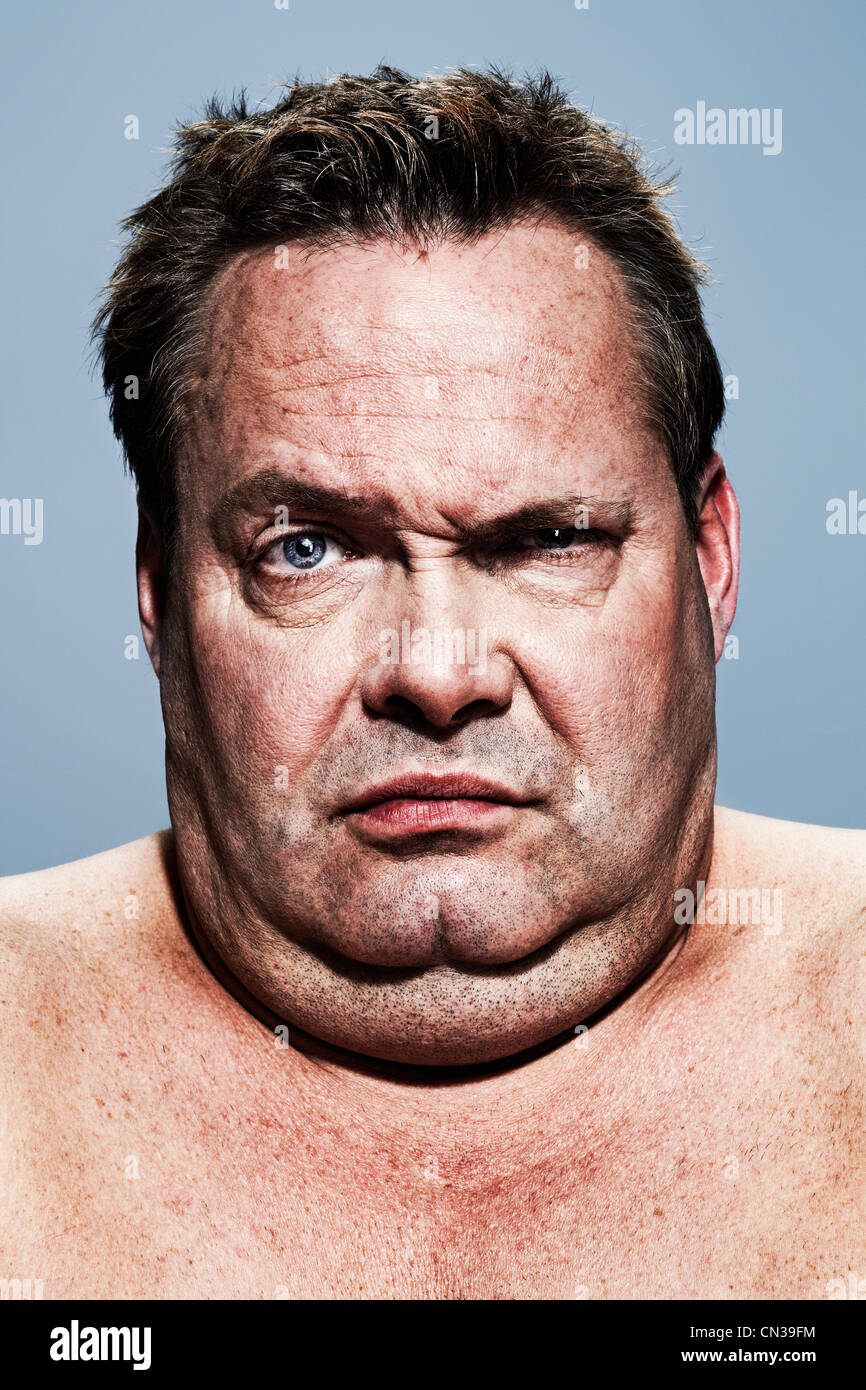 Man with double chin and raised eyebrow - Stock Image
