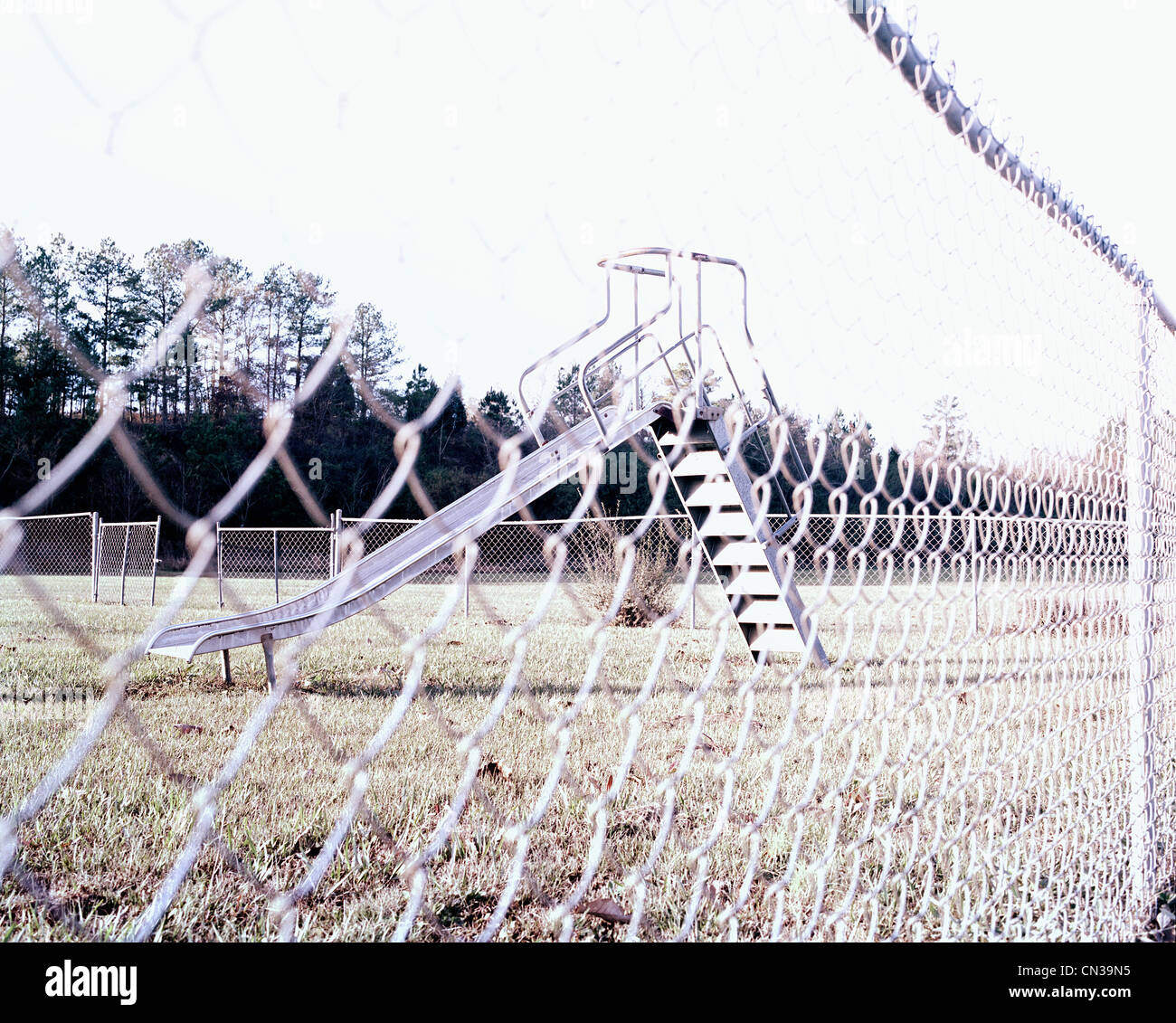 Playground through chain link fence - Stock Image