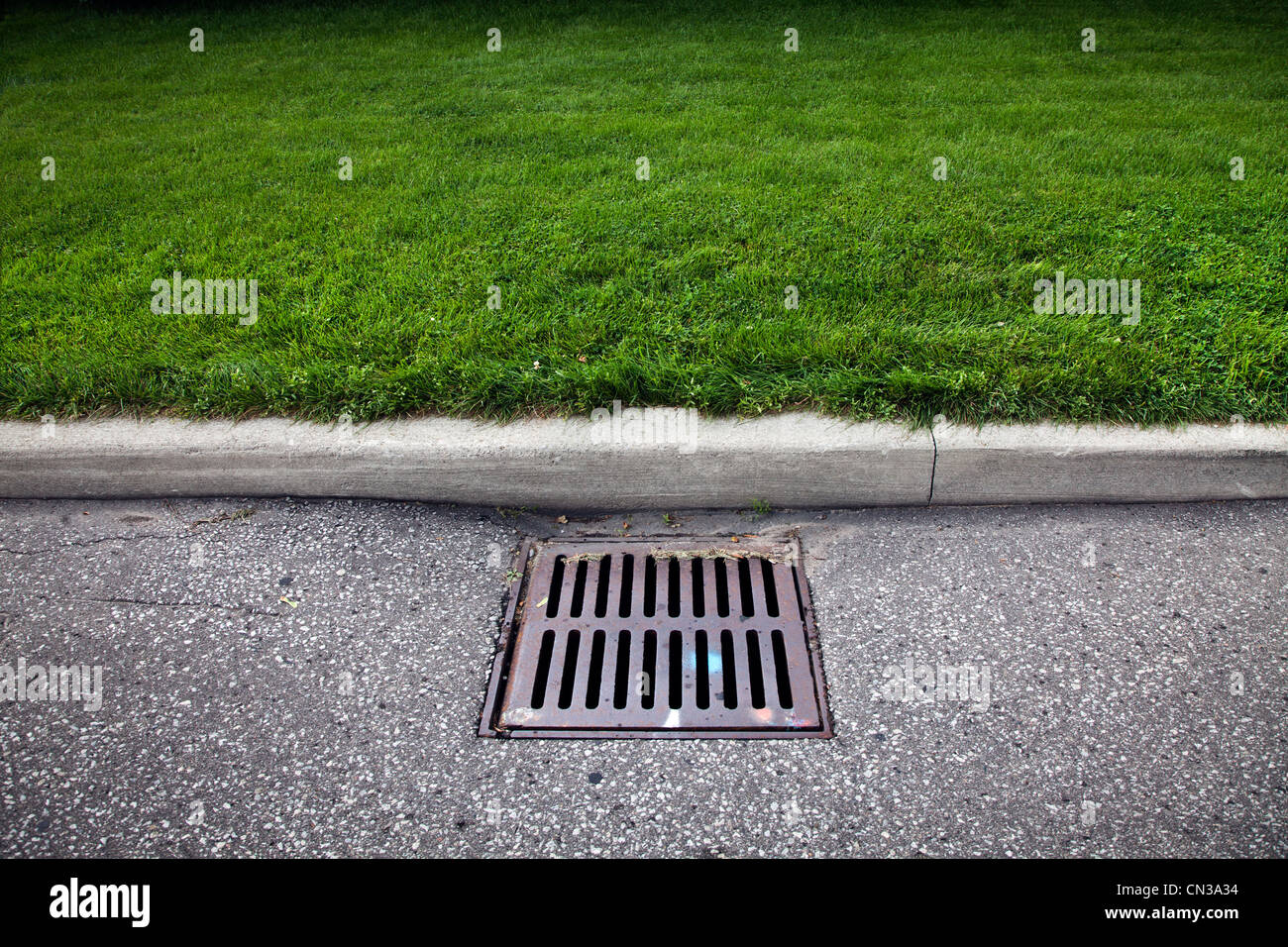 Drain on road - Stock Image