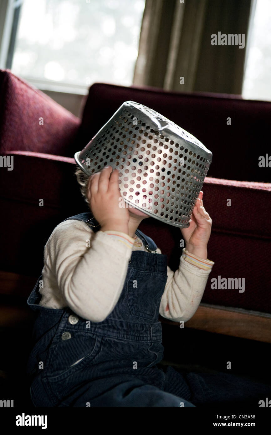 Boy with colander on head Stock Photo