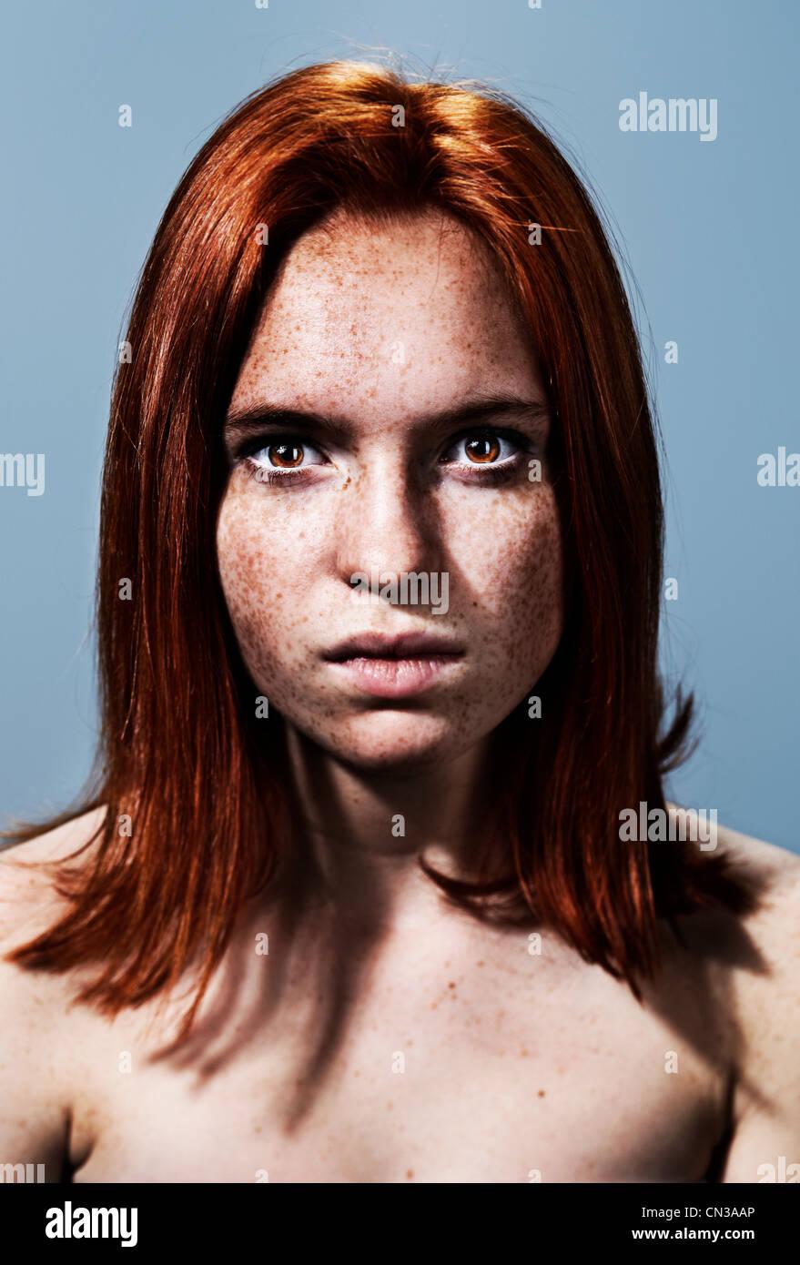 Portrait of teenage girl looking intense - Stock Image