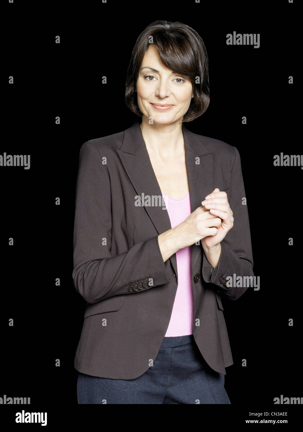 Woman with hands clasped, portrait - Stock Image